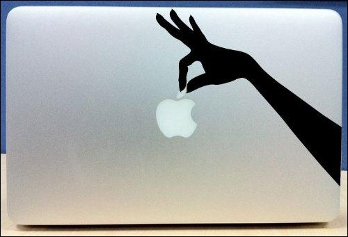 hand-holding-apple-macbook-sticker