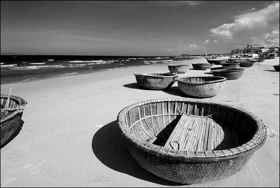 grey-boats,-white-sand